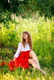 Portrait of blonde woman sitting under the tree Royalty Free Stock Photo
