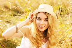 Portrait of Blonde Woman at Summer Field Stock Photography