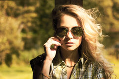 Portrait of Blonde Woman with Sunglasses Stock Images