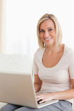 Portrait of a blonde woman using a laptop Stock Image