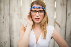 Portrait of a blonde woman wearing glasses and headband Stock Photo