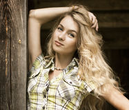 Portrait of Blonde Woman at the Wooden Background Royalty Free Stock Photography