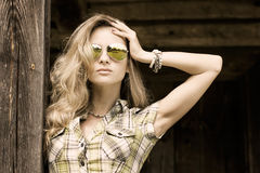 Portrait of Blonde Woman at the Wooden Background Royalty Free Stock Images
