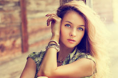 Portrait of Blonde Woman at the Wooden Background Stock Photography