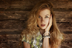 Portrait of Blonde Woman at the Wooden Wall Royalty Free Stock Photos