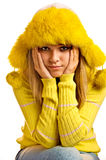 Portrait of blonde in yellow fur cap Stock Photos