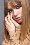 Portrait of blonde young woman. Female with green eyes and long Royalty Free Stock Photo
