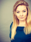 Portrait blonde young woman having serious face expression Royalty Free Stock Image