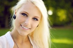 Portrait of blonde young woman outdoors Royalty Free Stock Photos