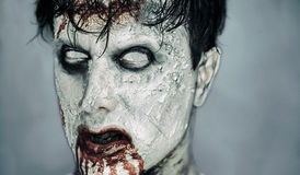 Portrait of bloody zombie man. Portrait of scary bloody zombie man with white eyes. Halloween or horror theme Stock Photos