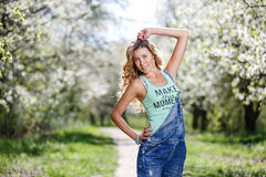 Portrait in the blossoming of apple-trees. Female street portrait in blossoming of apple-trees Stock Photos