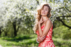 Portrait in blossoming of apple-trees. Female street portrait in blossoming of apple-trees Royalty Free Stock Photo