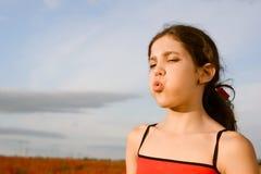 Portrait blow teen girl Royalty Free Stock Photos