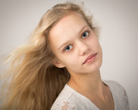 Portrait Of A Blue Eyed Blond Teenage Girl Stock Photos