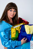 Portrait of blue-eyed brunette with  packages Stock Photography