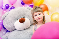 Portrait of blue-eyed girl with big teddy bear Royalty Free Stock Photography