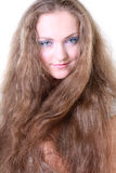 Portrait of a blue-eyed girl with long hair Stock Photography