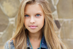 Portrait of blueeyed pretty blonde girl Royalty Free Stock Photo