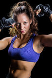 Portrait of bodybuilder with fighting stance. Against black background royalty free stock photography