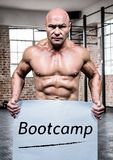 Portrait of bodybuilder holding placard with text bootcamp Stock Photo