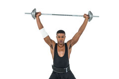 Portrait of bodybuilder lifting heavy barbell weights Stock Image