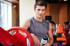 Portrait of a bodybuilder resting after workout at fitness gym Royalty Free Stock Photography