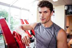 Portrait of a bodybuilder resting after workout at fitness gym Stock Photography