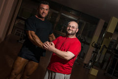 Portrait of bodybuilder and training partner Royalty Free Stock Image