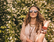 Portrait of boho young chic among flowers Stock Image
