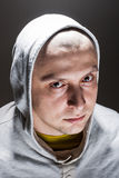 Portrait of a bold man. In a hoodie stock photo