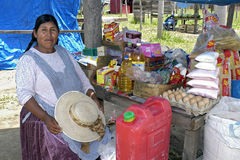 Portrait of Bolivian Market Merchant of grocery. Bolivia: Elderly Indian woman sells food products in colorful packaging on a market in the city of Santa Cruz Stock Photo