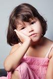 Portrait of bored little Asian girl. The portrait of bored little Asian girl stock photo