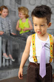 Portrait of a bored little boy with friends Royalty Free Stock Image