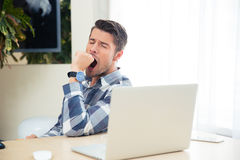 Portrait of a bored man yawning Royalty Free Stock Images