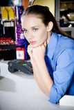 Portrait of a bored supermarket checkout assistant Stock Photo