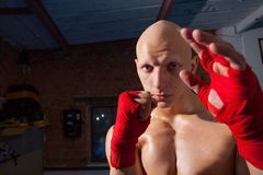 Portrait of a boxer with fists in red bandages Royalty Free Stock Photos