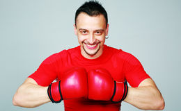 Portrait of a boxer with his gloves together Stock Photos