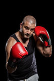 Portrait of boxer performing uppercut Royalty Free Stock Photos