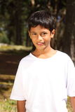Portrait of boy 10 in the bright forest sunshine Stock Photos