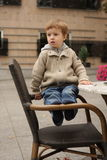Portrait of a boy. A boy, sitting on the chair Stock Image