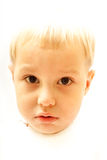 Portrait of  boy. Bleached Portrait of cute  boy looking to the camera Royalty Free Stock Photos