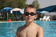 Portrait of a boy. Boy swimming in the pool during the summer holidays Stock Photography