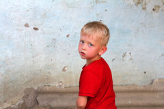 Portrait of the boy. Against a dirty wall Stock Photos