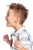 Portrait of boy. Close-up of portrait happy boy shouting on white background Royalty Free Stock Image