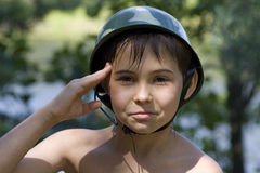 Portrait of the boy. A military greeting during game Royalty Free Stock Image