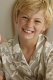 Portrait of a boy. Portrait of an 8-year-old blond boy laughing Stock Photography