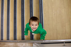 Portrait of a boy from above, standing on a stairs Royalty Free Stock Photos