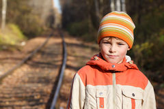 Portrait of boy autumn sunny day on railway Royalty Free Stock Photos