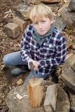 Portrait of a Boy with an Axe Cutting Wood Royalty Free Stock Photography