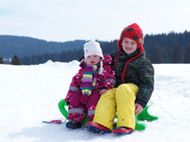 Portrait of boy and baby girl on winter vacation Stock Photos